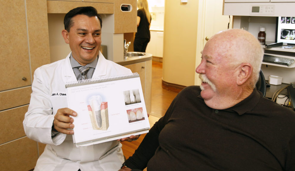Dr. Chavez and a patient discuss treatment during a dental implant consultation.